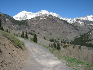 Climbing!  The view to the north is the Maroon Bells - Snowmass wilderness. Tall mountain is Snowmass Peak.
